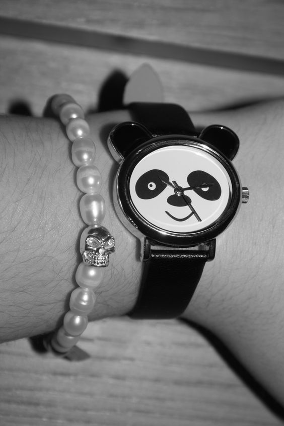 My pearl and skull ChloBo bracelet and Panda watch from New Look.