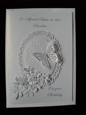 handmade Birthday card by: JEWELS62 ... white on white ... die cut creation ... flowers, butterfly and label ... wonderful card!!