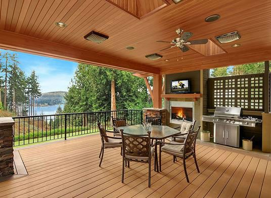this covered bbq deck features a fireplace and grilling. Black Bedroom Furniture Sets. Home Design Ideas