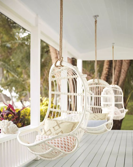 Hanging chairs on a covered porch. Hanging Rattan ChairHanging Rattan Chair: