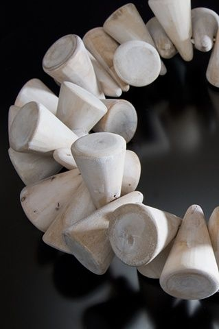 Driftwood necklace of cones, strung on elastic. Nina Morrow