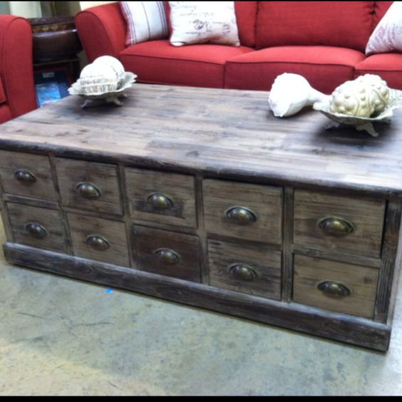 Distressed coffee table with drawers