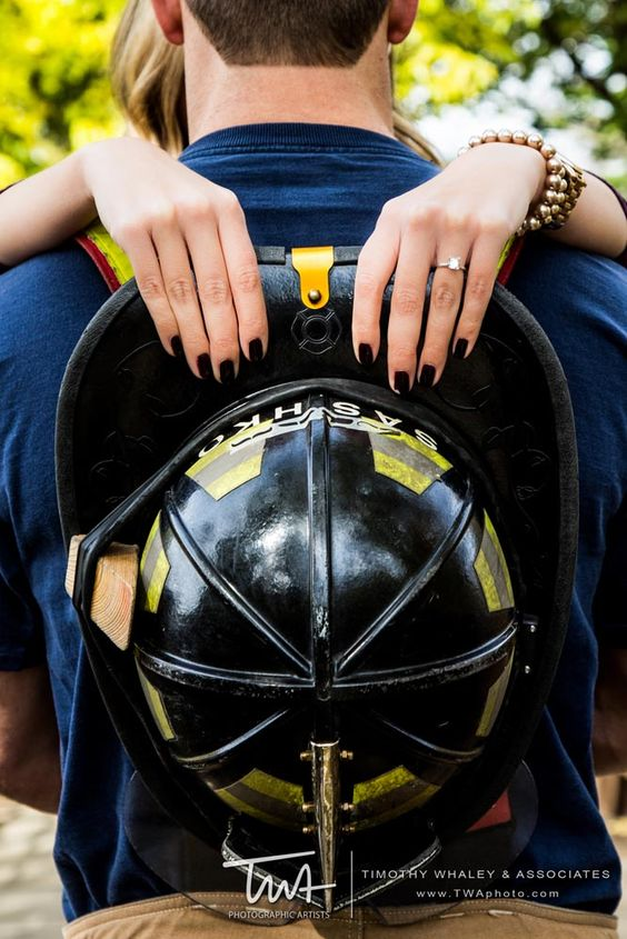 Firefighter Engagement Session! Cute ring shot with his helmet over his shoulders.