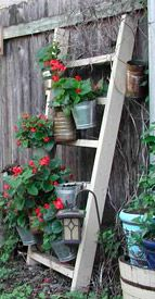 former baby crib becomes garden decor