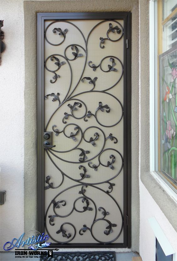 Scrolled wrought iron security screen door with leaves for Window scroll function