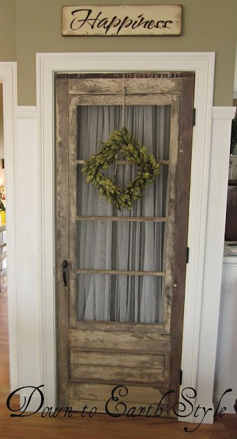 Maybe I should put fabric on the doors, so noone can see thru them...  Hmmm..  Plus a GREAT backdrop for wreaths!  Ck out the other ideas from this website, including the backsplash in the kitchen - maybe an idea for mine?
