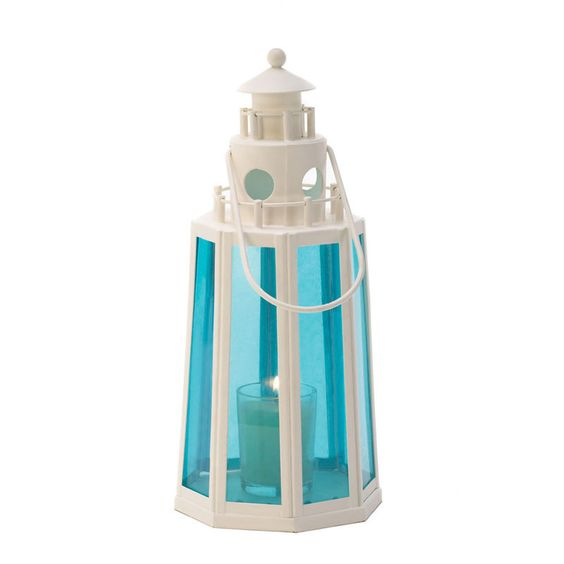 Indoors or out, the ocean-blue glass and white metal of this lighthouse lantern is a cheerful coastal accent for your home. Place a candle inside warm radiance.