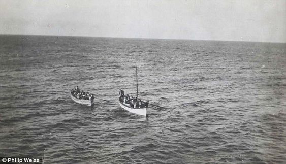 Survivors from the Titanic are pictured here rowing towards rescue ship the Carpathia in what appear to be relatively calm seas