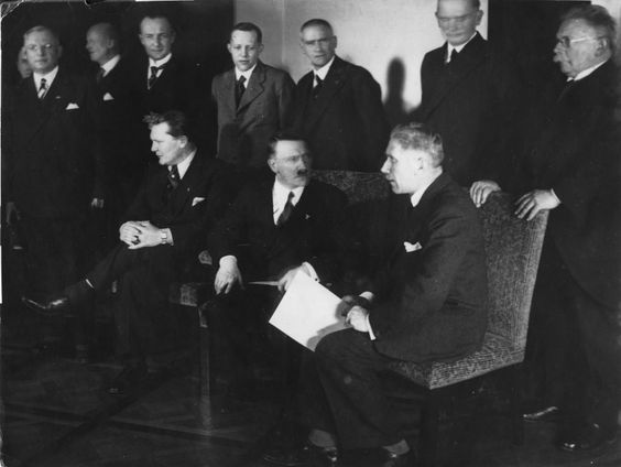 """""""The makeup of the present cabinet, with its normally discordant elements, furnishes a fertile field for trouble,"""" wrote US ambassador Frederic M. Sackett in 1933. (Front row from left to right: Hermann Göring, Adolf Hitler, Franz von Papen. Second row standing from right to left are: Alfred Hugenberg, Werner von Blomberg, Wilhelm Frick, Johann Ludwig Graf Schwerin von Krosigk, Paul Freiherr Eltz von Ruebenach and Franz Beldte.)"""