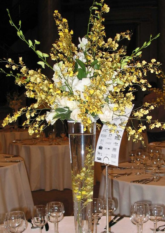 This is a tall centerpiece featuring yellow oncidium