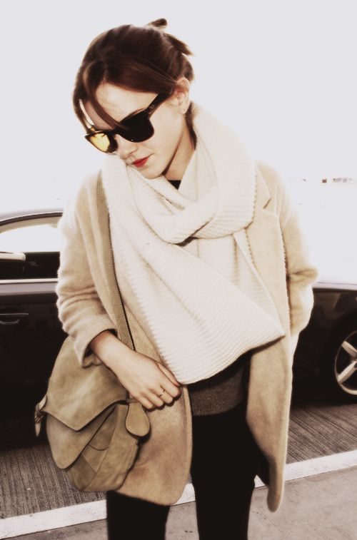 Emma Watson: minimal and classic // Love the cream scarf layered over the camel jacket.: