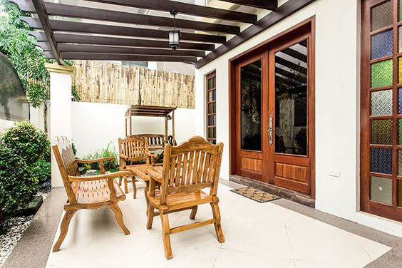 Near the front door of the two-storey house is a swinging bench and three wooden seats. This is the perfect place for entertaining guests on a breezy and beautiful day.
