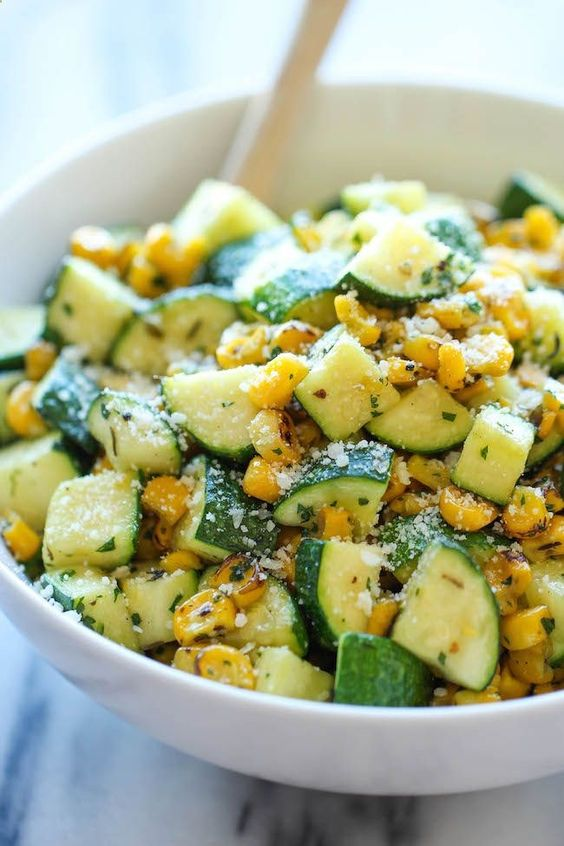 Parmesan Zucchini and Corn - A healthy 10 minute side dish to dress up any meal. Its so simple yet full of flavor! Check out more recipes like this! Visit yumpinrecipes.com/