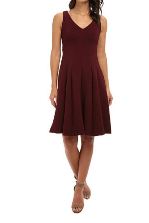 Fitted with inverted pleats at full skirt for gentle pleating throughout. This ottoman-knit dress flaunts a classic A-line silhouette. Deep V neck and back line. Sleeveless construction. Subtle seaming throughout creates a tailored fit. Concealed zipper closure at back creates a sleek allover appearance. Flared hemline hits just above the knee.    Ottoman Plunge Dress by Nanette Lepore. Clothing - Dresses - Wedding Wear New Hampshire