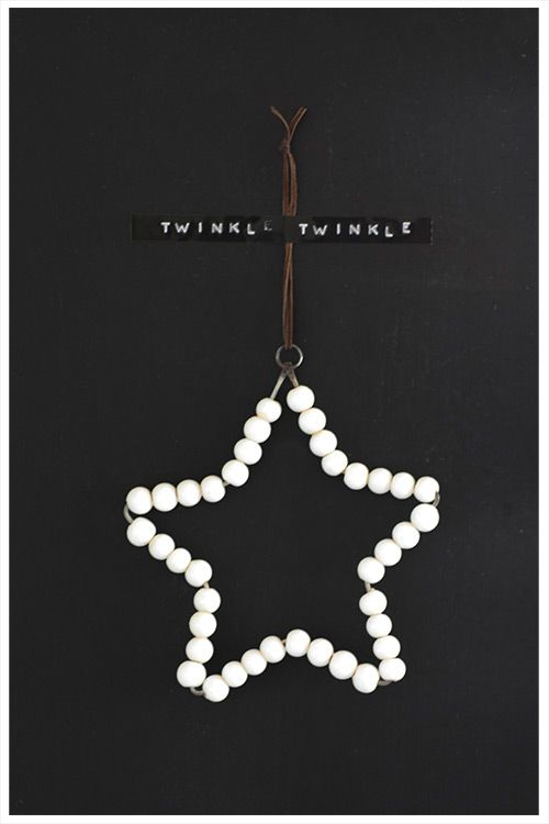 Lovely round white beads on star-shaped wire Christmas ornament, strung with leather.: