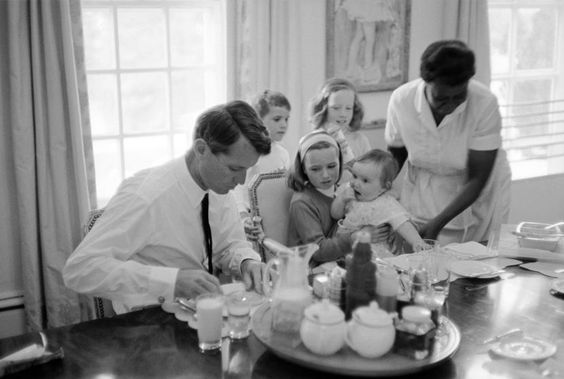 Robert F. Kennedy eats breakfast with his family, 1964.