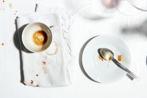 Photo : Coffee cup, plate and dirty napkin, view from above