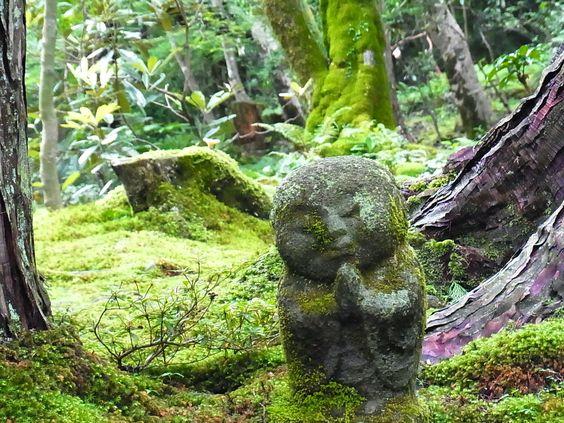 Moss-covered Jizō Buddha Statue at Sanzen-in Temple and moss garden, Ohara, Japan