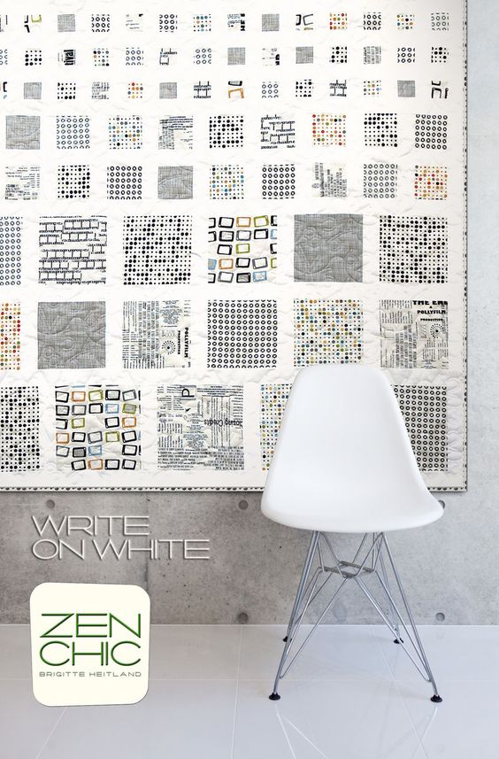 Simplicity at it's best: Like a quilter's eye chart the scale of the squares becomes smaller and smaller. This quilt WRITE ON WHITE features only the white fabric scale of the REEL TIME collection by ZEN CHIC: