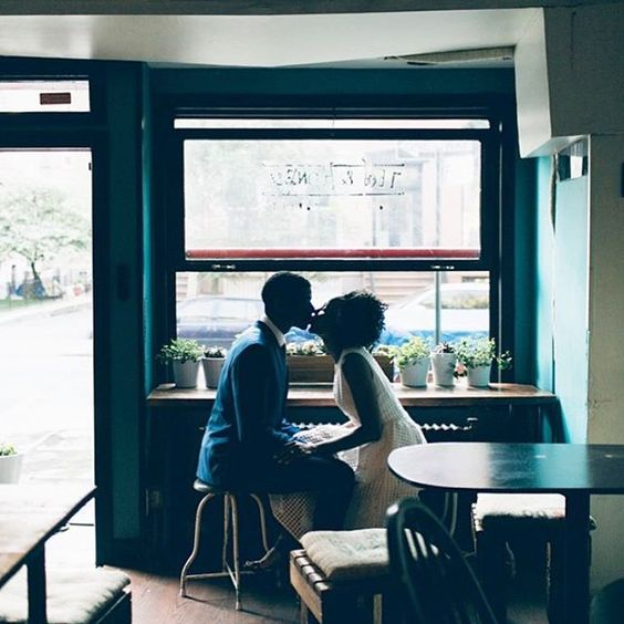 Coffee shop kiss. Non-cheesy, new york engagement photography. (engagement shoot: UNIQUE LAPIN)