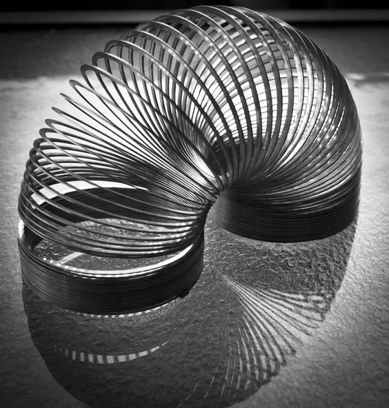 Slinky reflection. I love using dramatic light and shadow in photos.
