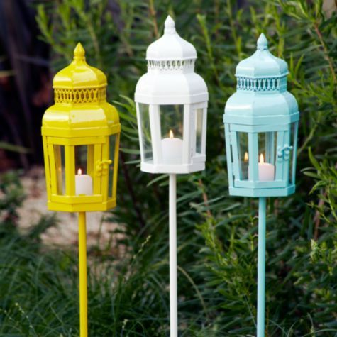 Summer Entertaining - This is a highly functional lantern with a hinged door that secures a glowing candle and a stake post that allows you to illuminate any outdoor setting—you can plant it in grass, sand or soil. Available in Aquamarine blue, Lemon yellow and White.