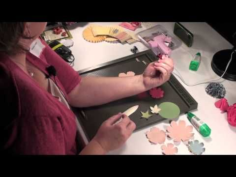Video for all kinds of flower punches - awesome! She uses a mist of water & then a bone folder to twirl the punched out circles, flower shapes, etc into a 3D petal. She gives the recipes for how many petals for each flower shape.