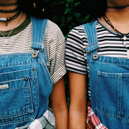 dungarees, striped tees, surfer necklaces and plaid shirt combo.