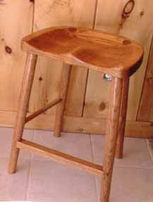 THE VILLAGE WOODWORKER of Oxford, Maine - these chairs and stools are crazy comfy. tons of types of woods and finishes.