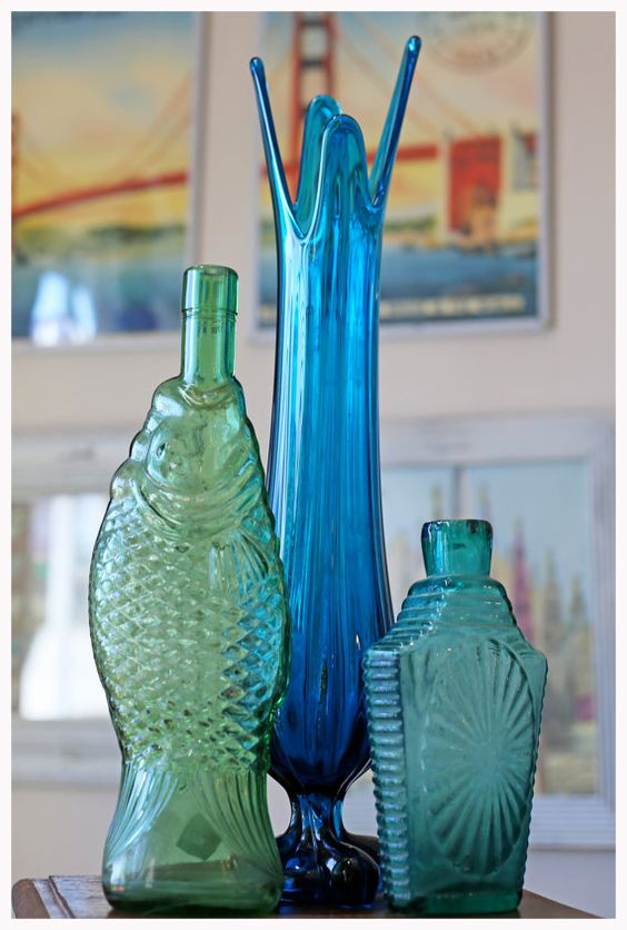 Group different color glass together for a pretty display!  Blue Vintage Glass Vase by PeaceandPoetry on Etsy, $90.00