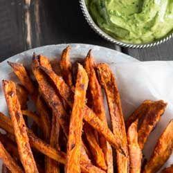 Crispy sweet potato fries with avocado-coriander dip