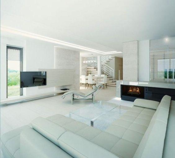 weißes wohnzimmer minimalistisch relaxsessel ecksofa kamin