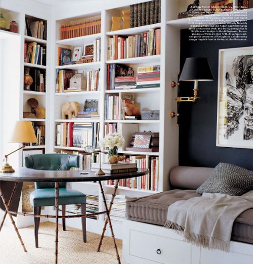 details I like: a nook by the book shelf and a table the shape of a half-moon • also: that table's legs • photo uncredited • via coco+kelley