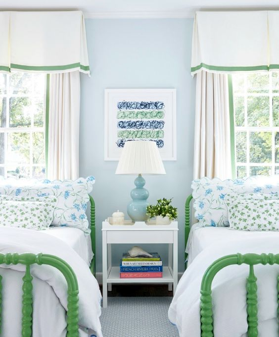 Decor Inspiration from Sarah Bartholomew in this children's bedroom with light blue walls, bright green beds, and traditional draperies.
