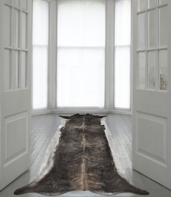 Super Long Stretched Cowhide  Designed by Young & Battaglia  Made in England | http://www.mineheart.com/products/cowhiderug.html