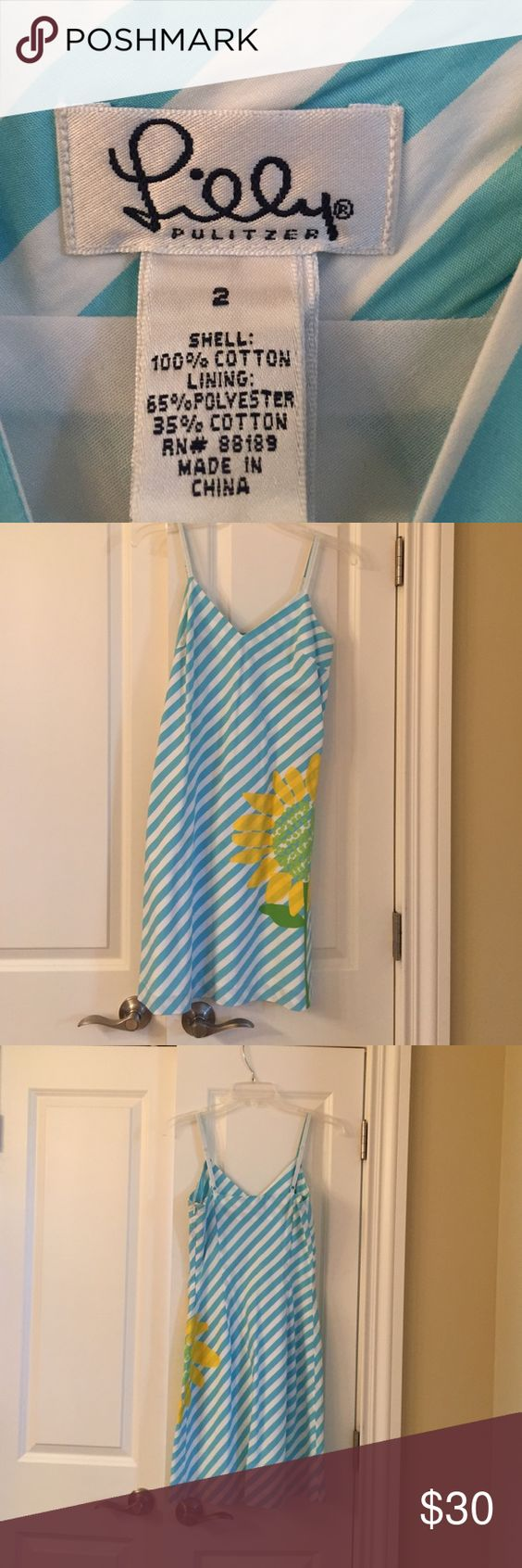 Lily Pulitzer sun dress.  Worn twice.  Like new Aqua blue and white diagonal stripes with yellow sunflower on side Lilly Pulitzer Dresses Mini