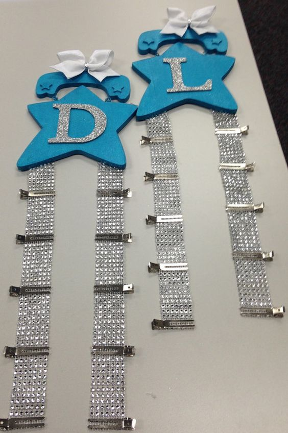 Customizable cheer bow holder. Holds up to 10 cheer bows. Choose star color, letter and letter color, and top bow color. Clip holders are