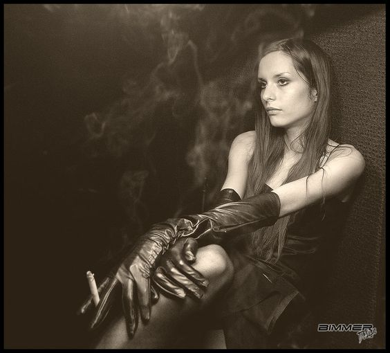 smoking girl in leather gloves