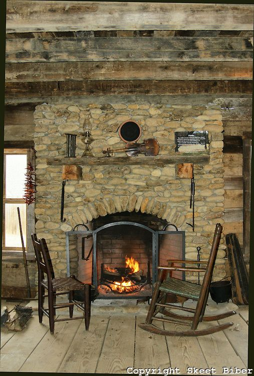Coins fireplaces and cabin on pinterest for Cabin fireplace pictures
