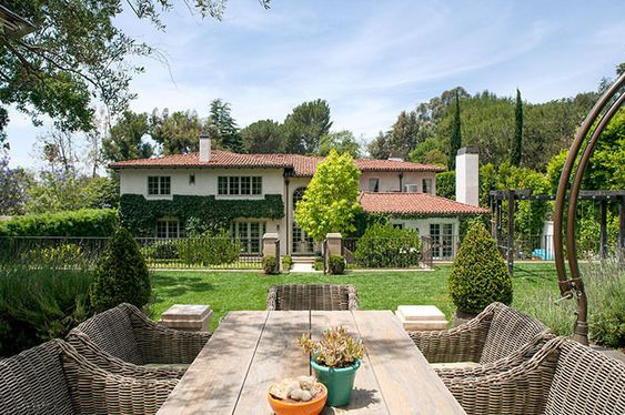 Reese Witherspoon's Home is What Backyard Dreams Are Made Of// woven outdoor chairs, exterior inspiration