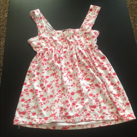 Red and white babydoll tank top Babydoll tank top with red/orange floral designs Cant miss Tops Tank Tops