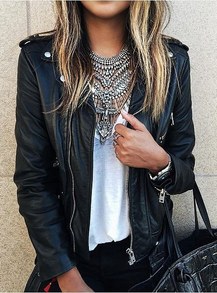A leather jacket, t-shirt, and statement necklace.