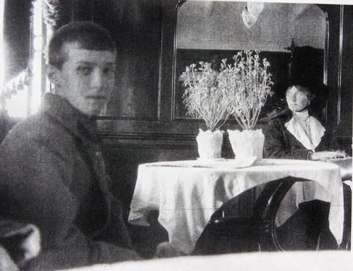The last photo taken of Alexei (13) and Olga (22) Romanov before their murder on July 17, 1918.