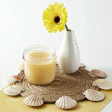 Place mat with shells glued to edge and flower vase
