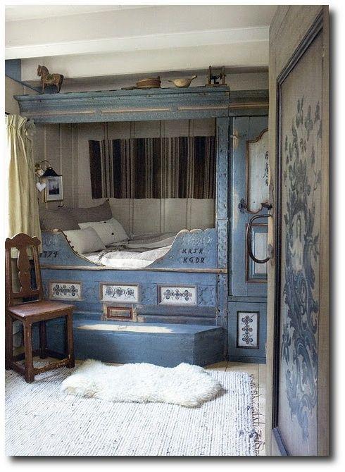Scandinavian Swedish Country Style. Scandinavian bed with folk art.