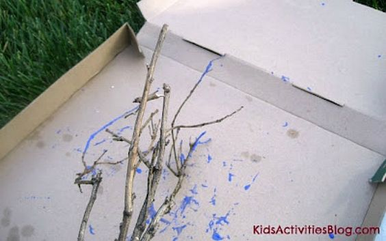 Painting with tree branches - great kids outdoor activity!