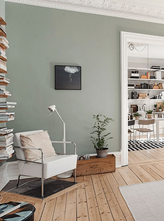 living room with olive gray walls, olive green, sage green, gray-green, green-gray, army green, grunge green, sherwin williams acier, white trim, natural wood floors