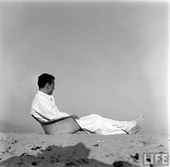 Charles Eames on the beach in Santa Monica, sitting on an #Eames fiberglass shell #shellspotting