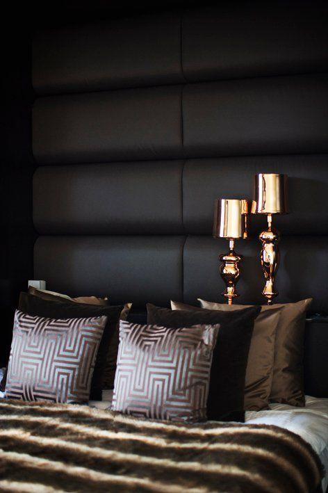 Eric Kuster. BLANKET on bed. Love. Dark soft headboard, lamps ...