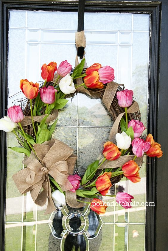 Cute tulip wreath. Make for mom's mother's day gift. Shhhh, don't tell, sisters - that means you too 'Shan' and 'Chris'. I know you fellas love crafting with silk flowers and all, but let's keep this between us, so I can surprise mom. :P